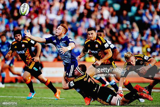 Ihaia West of the Blues loses the ball forward during the round one Super Rugby match between the Blues and the Chiefs at QBE Stadium on February 14,...