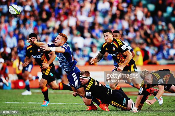 Ihaia West of the Blues loses the ball forward during the round one Super Rugby match between the Blues and the Chiefs at QBE Stadium on February 14...