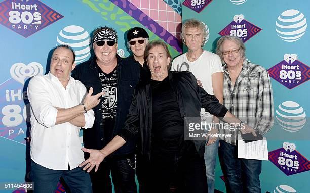 iHeartMedia radio personality Mark Wallengren poses with musicians Matt Frenette Mike Reno Paul Dean Doug Johnson and Ken Spider Sinnaeve of Loverboy...