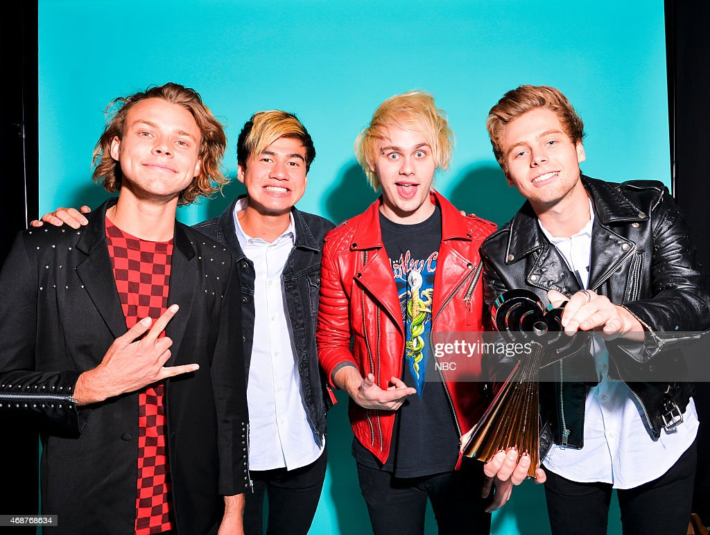 Ashton Irwin, Luke Hemmings, Michael Clifford and Calum Hood of 5 Seconds of Summer pose in the NBC photo booth during the 2015 iHeartRadio Music Awards held at the Shrine Auditorium on March 29, 2015 in Los Angeles, California.--