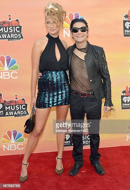 iHEARTRADIO MUSIC AWARDS Pictured Model Courtney Anne and actor Corey Feldman arrive at the iHeartRadio Music Awards held at the Shrine Auditorium on...