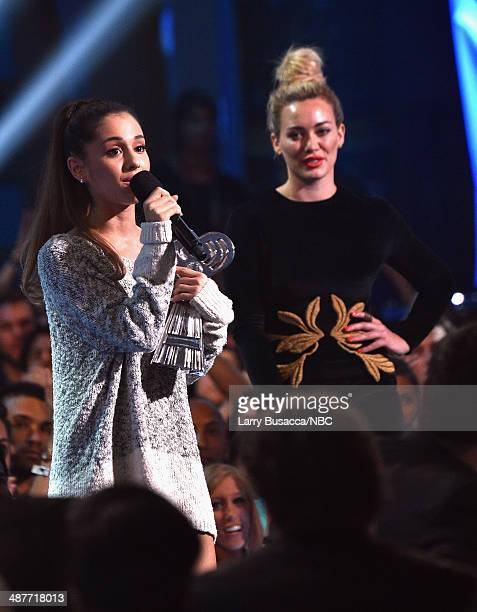 iHEARTRADIO MUSIC AWARDS Pictured Singer Ariana Grande accepts the iHeartRadio Young Influencer Award from actress Hilary Duff onstage during the...
