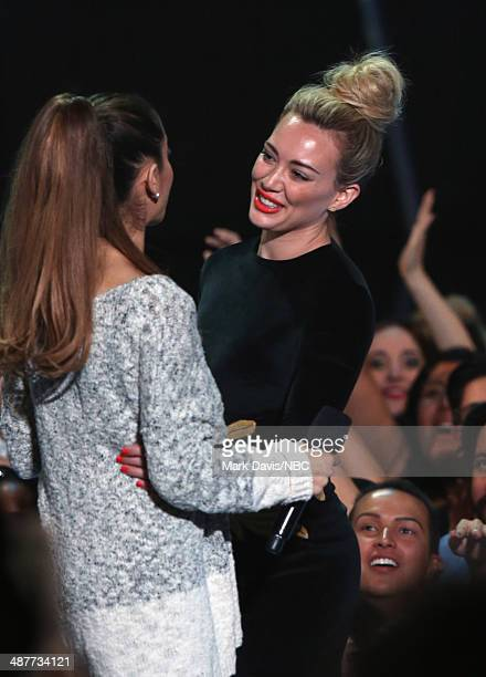 iHEARTRADIO MUSIC AWARDS Pictured Singer Ariana Grande and actress Hilary Duff onstage during the iHeartRadio Music Awards held at the Shrine...