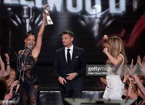 iHEARTRADIO MUSIC AWARDS Pictured Singer Rihanna accepts the award for Artist of the Year from Ryan Seacrest and Jennifer Lopez onstage during the...