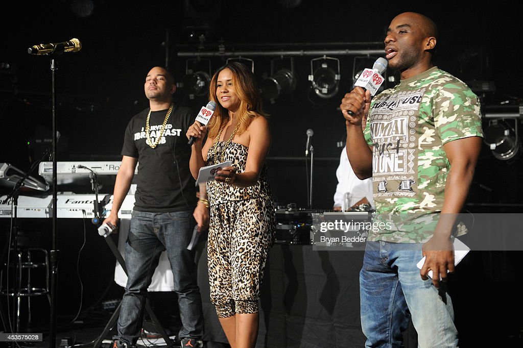 iHeartRadio's DJ Envy, Angela Yee, and Charlamagne Tha God of The Breakfast Club speak onstage at the Wiz Khalifa performance at the iHeartRadio Live P.C. Richard & Son Theater on August 13, 2014 in New York City.