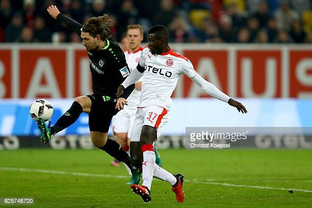 Ihlas Bebou of Duesseldorf challenges Stefan Strandberg of Hannover during the Second Bundesliga match between Fortuna Duesseldorf and Hannover 96 at...