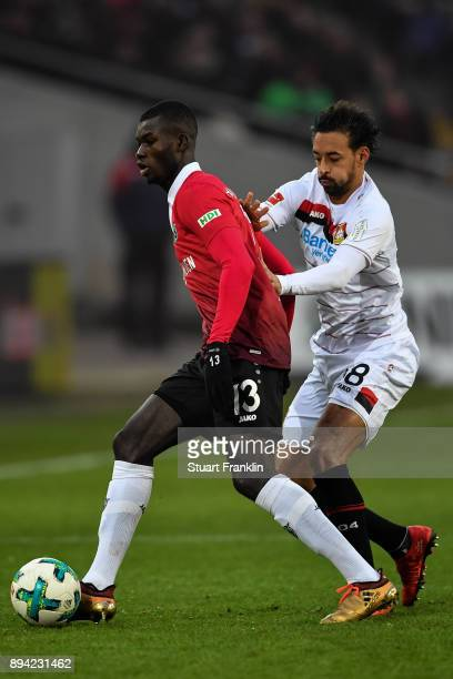 Ihlas Bebou of Hannover 96 and Karim Bellarabi of Bayer Leverkusen battle for the ball during the Bundesliga match between Hannover 96 and Bayer 04...