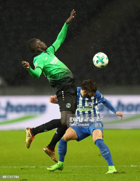 Ihlas Bebou of Hannover 96 battles for the ball with Marvin Plattenhardt of Hertha BSC during the Bundesliga match between Hertha BSC and Hannover 96...