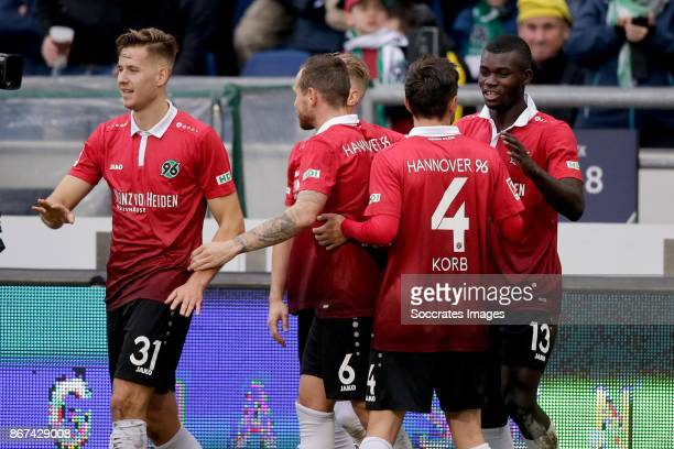 Ihlas Bebou of Hannover 96 celebrates 21 with Waldemar Anton of Hannover 96 Julian Korb of Hannover 96 during the German Bundesliga match between...