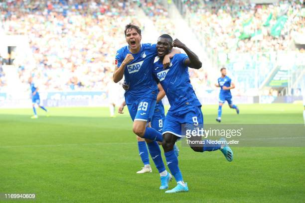 Ihlas Bebou of Hoffenheim celebrates his goal with Robert Skov during the Bundesliga match between TSG 1899 Hoffenheim and SV Werder Bremen at...