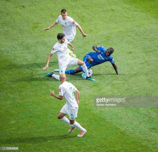 Ihlas Bebou of Hoffenheim is challenged by Maximilian Eggestein, Nuri Sahin and Oemer Toprak of Bremen during the Bundesliga match between TSG 1899...
