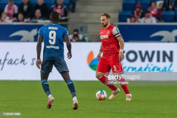 Ihlas Bebou of TSG 1899 Hoffenheim and Rafael Czichos of 1.FC Koeln battle for the ball during the Bundesliga match between TSG Hoffenheim and 1. FC...