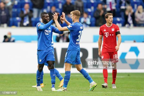 Ihlas Bebou of TSG 1899 Hoffenheim and teammate Stefan Posch celebrate at full time of the Bundesliga match between TSG Hoffenheim and FC Bayern...