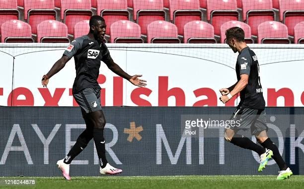 Ihlas Bebou of TSG 1899 Hoffenheim celebrates with Christoph Baumgartner after scoring his team's first goal during the Bundesliga match between 1...