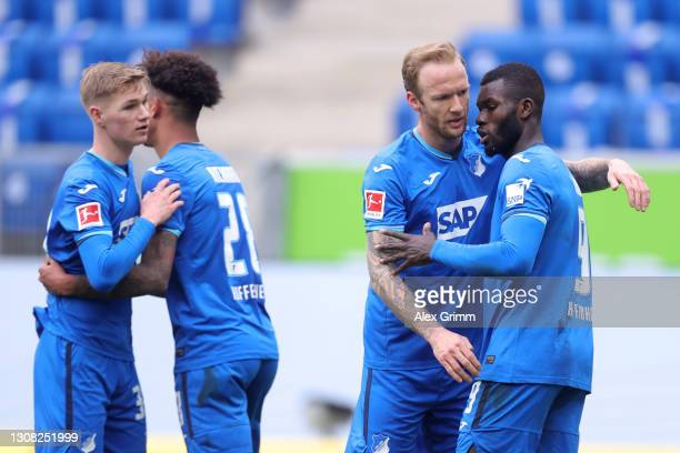 Ihlas Bebou of TSG 1899 Hoffenheim celebrates with Kevin Vogt after scoring their side's first goal during the Bundesliga match between TSG...