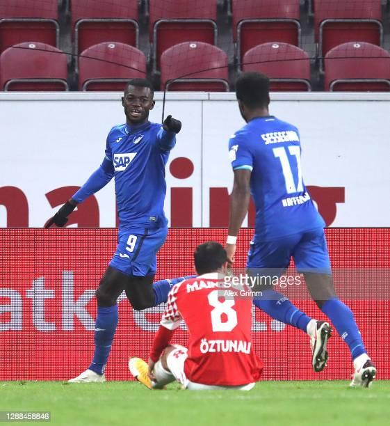 Ihlas Bebou of TSG 1899 Hoffenheim celebrates with Ryan Sessegnon after scoring their team's first goal during the Bundesliga match between 1. FSV...