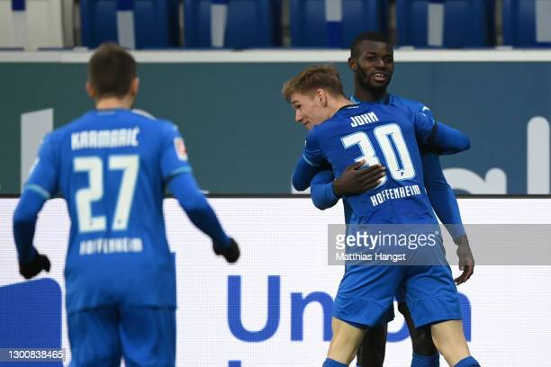 Ihlas Bebou of TSG 1899 Hoffenheim celebrates with team mate Marco John after scoring their side's first goal during the Bundesliga match between TSG...