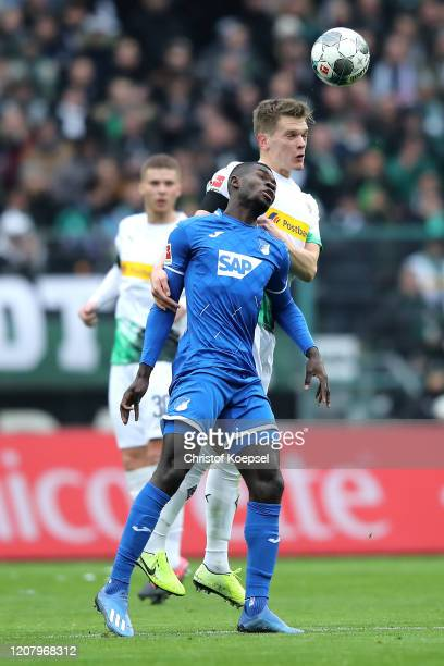 Ihlas Bebou of TSG 1899 Hoffenheim jumps with Matthias Ginter of Borussia Monchengladbach during the Bundesliga match between Borussia...