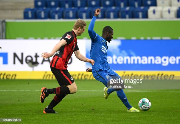 Ihlas Bebou of TSG 1899 Hoffenheim scores their side's first goal whilst under pressure from Martin Hinteregger of Eintracht Frankfurt during the...