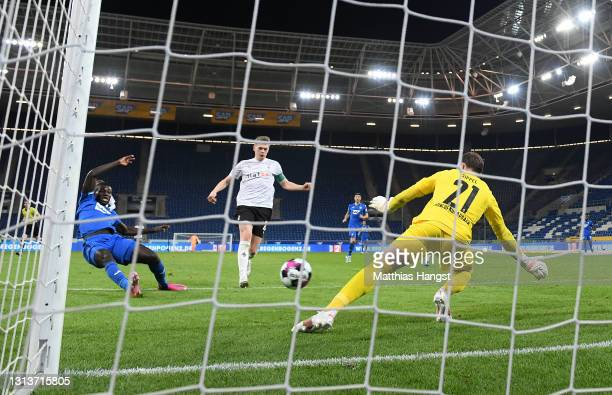 Ihlas Bebou of TSG 1899 Hoffenheim scores their sides second goal past Tobias Sippel of Borussia Moenchengladbach during the Bundesliga match between...