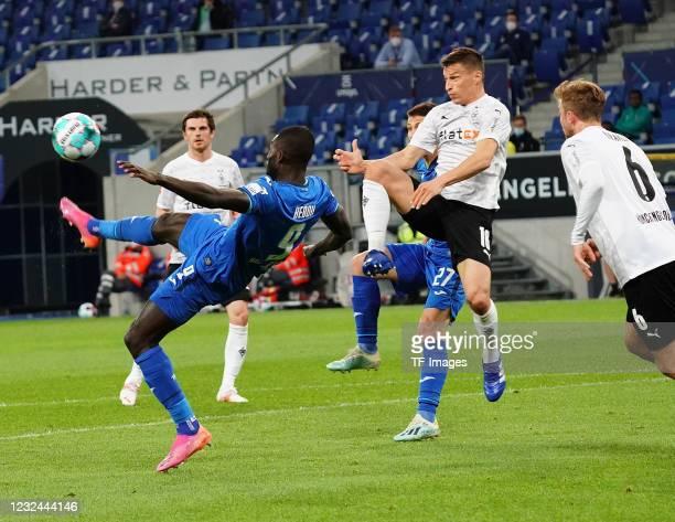 Ihlas Bebou of TSG Hoffenheim, Stefan Lainer of Borussia Moenchengladbach , Christoph Kramer of Borussia Moenchengladbach during the Bundesliga match...