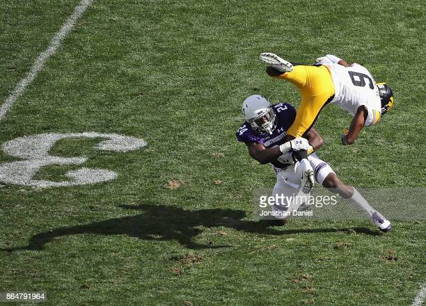 Ihmir SmithMarsette of the Iowa Hawkeyes is upended for a loss on a reverse by Montre Hartage of the Northwestern Wildcats at Ryan Field on October...