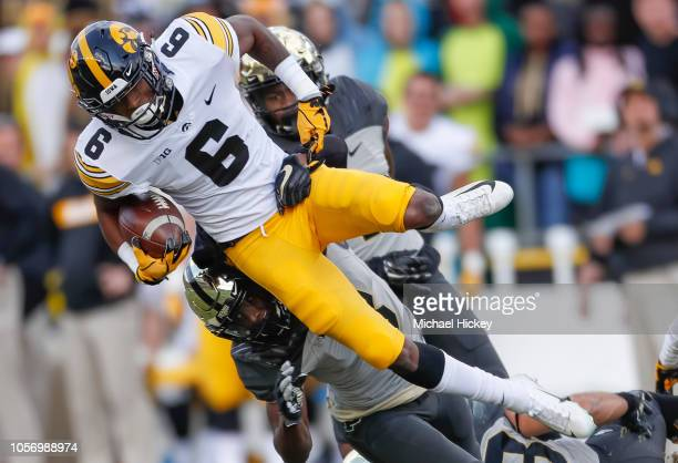 Ihmir SmithMarsette of the Iowa Hawkeyes runs the ball and is tackled by Markell Jones of the Purdue Boilermakers in the first half at RossAde...