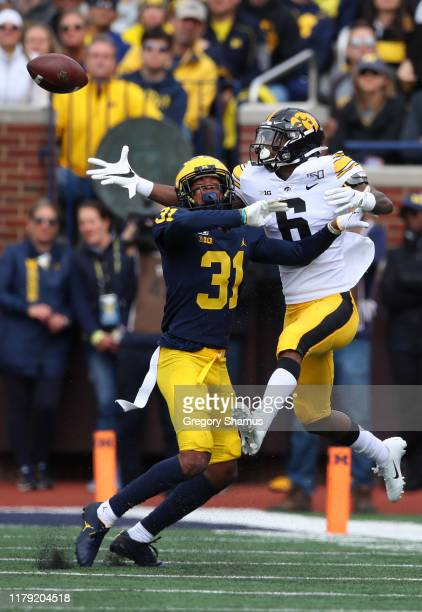 Ihmir Smith-Marsette of the Iowa Hawkeyes tries to make a first quarter catch next to Vincent Gray of the Michigan Wolverines at Michigan Stadium on...