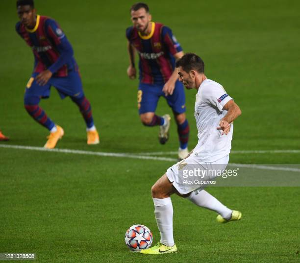 Ihor Kharatin of Ferencvaros Budapest scores his sides first goal from the penalty spot during the UEFA Champions League Group G stage match between...