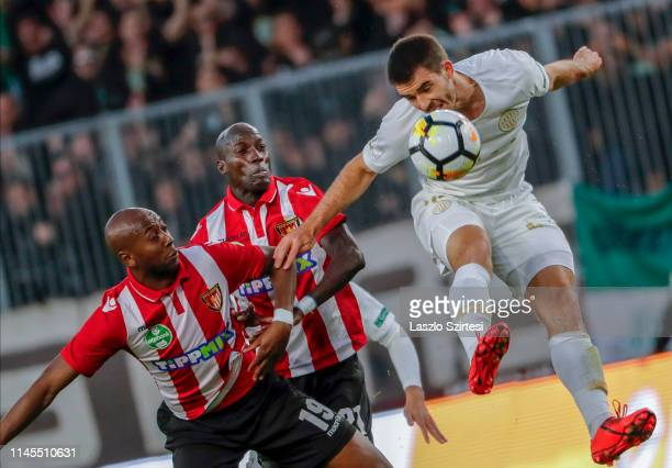 Ihor Kharatin of Ferencvarosi TC battles for the ball in the air with Fousseni Bamba of Budapest Honved and Danilo Cirino de Oliveira of Budapest...