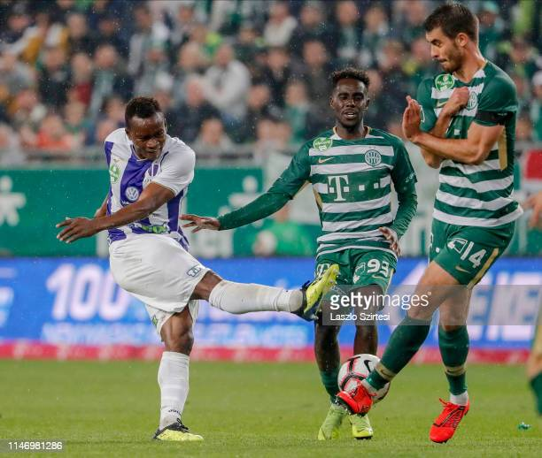 Ihor Kharatin of Ferencvarosi TC blocks the shot from Vincent Onovo of Ujpest FC before Tokmac Chol Nguen of Ferencvarosi TC during the Hungarian OTP...