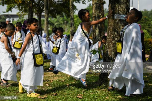 Ihramclad Muslim boys play after performing the ritual of stoning the devil during an educational simulation of the Hajj pilgrimage in Kuala Lumpur...