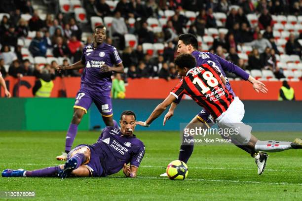 Ihsan Sacko of Nice and Gen Shoji and Christopher Jullien of Toulouse during the Ligue 1 match between Nice and Toulouse at Allianz Riviera Stadium...