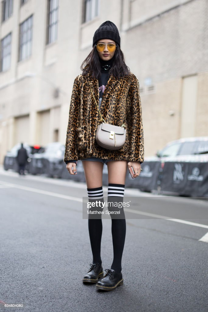 I-Hua Wu is seen attending Creatures of the Wind during New York Fashion Week wearing a leopard print jacket with black knee-high socks on February 11, 2017 in New York City.