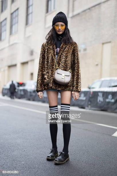 Hua Wu is seen attending Creatures of the Wind during New York Fashion Week wearing a leopard print jacket with black kneehigh socks on February 11...
