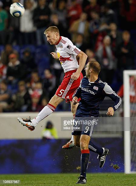 IIija Stolica of New England Revolution challenges Tim Ream of the New York Red Bulls on October 21 2010 at Red Bull Arena in Harrison New Jersey
