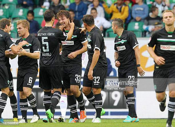 IIir Azemi of Fuerth jubilates with team mates after scoring the first goal during the Bundesliga match between VFL Wolfsburg and SpVgg Greuther...
