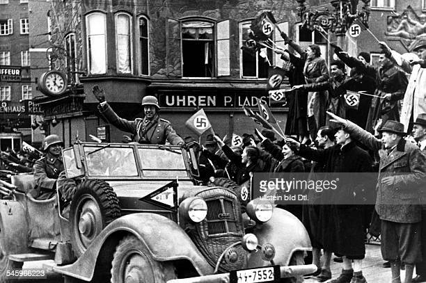 IIIReich annexation 'Anschluss' of Austria entry of 'Wehrmacht' into Austria 12 march 1938 Enthusiastically welcomed a SS unit passes through the...