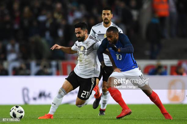 IIkay Gundogan of Germany and Alexandre Lacazette of France battle for possession during the international friendly match between Germany and France...