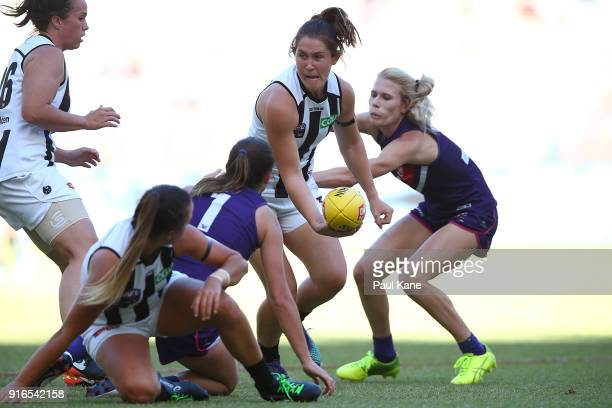 Iilish Ross of the Magpies looks to handball during the round two AFLW match between the Fremantle Dockers and the Collingwood Magpies at Optus...