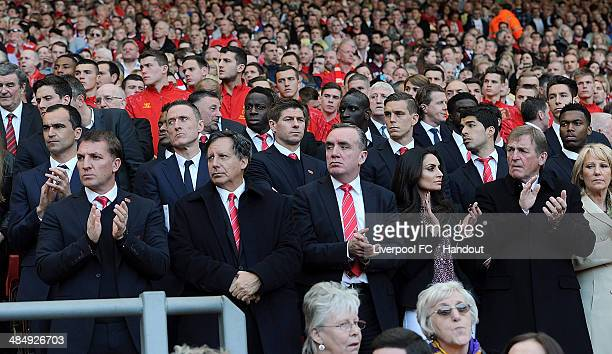 IIn this handout image provided by Liverpool FC, Brendan Rodgers manager of Liverpool, Chairman Tom Werner and Managing Director Ian Ayre and Kenny...