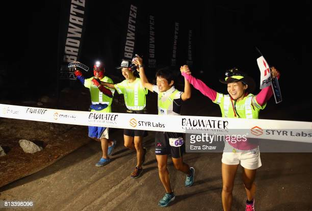 Iino Wataru of Japan crosses the finish line with his support team to win the STYR Labs Badwater 135 on July 11 2017 in Death Valley California...