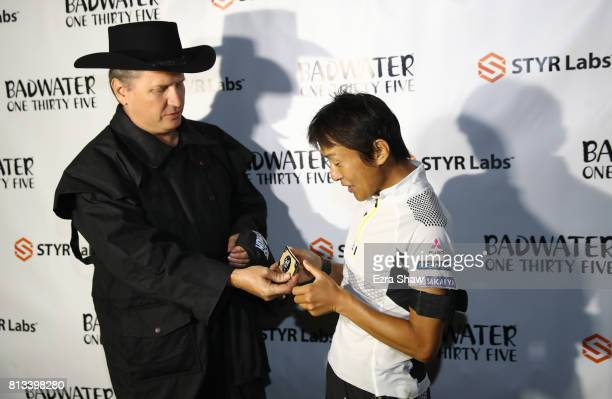 Iino Wataru of Japan is awarded the finisher belt buckle by race director Chris Kostman after winning the STYR Labs Badwater 135 on July 11 2017 in...