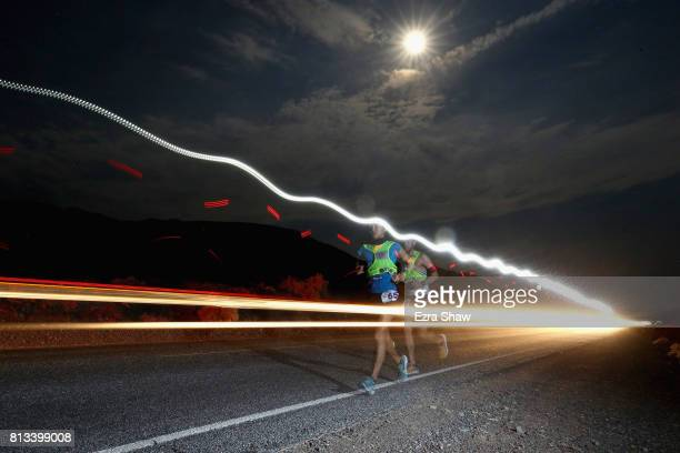 Iino Wataru of Japan is followed Pete Kostelnick of the USA during the STYR Labs Badwater 135 on July 11 2017 in Death Valley California Wataru went...