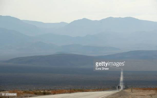 Iino Wataru of Japan is followed up a hill by Marco Bonfiglio of Italy during the STYR Labs Badwater 135 on July 11 2017 in Death Valley California...