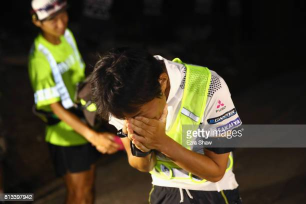 Iino Wataru of Japan reacts after winning the STYR Labs Badwater 135 on July 11 2017 in Death Valley California Wataru won the race with a time of 24...