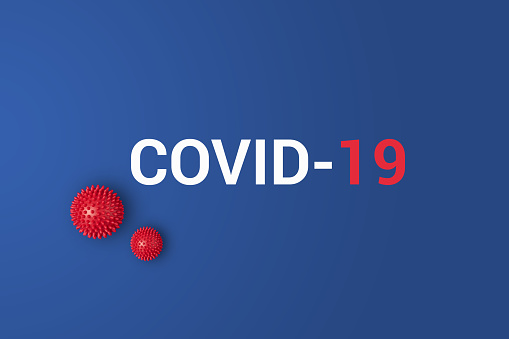 Iinscription COVID-19 on blue background with red ball 1205872351