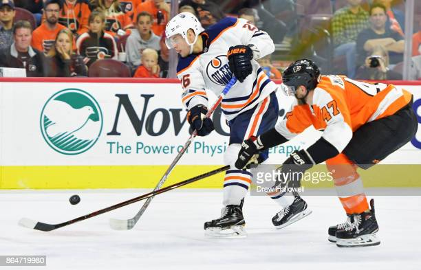Iiro Pakarinen of the Edmonton Oilers tries to get off a shot with Andrew MacDonald of the Philadelphia Flyers defending at the Wells Fargo Center on...
