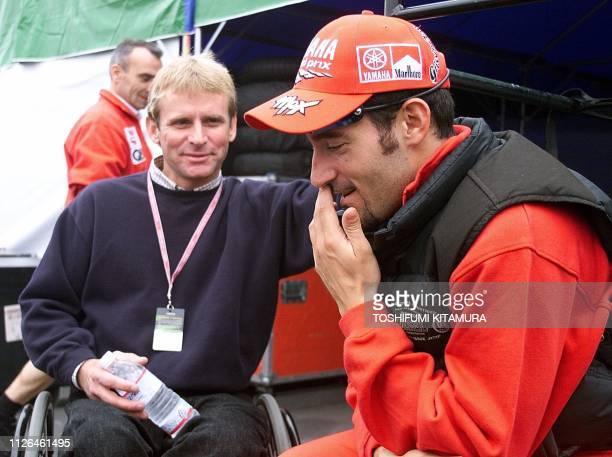 Iitalian Grand Prix rider Massimiliano Biaggi listens to former World 500cc champion and team manager Wayne Rainey prior to the 500cc qualifying...