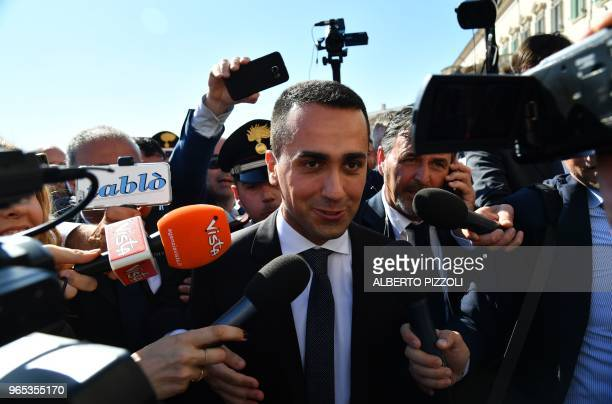 TOPSHOT IItalys Labor and Industry Minister and deputy PM Luigi Di Maio speaks to journalists after the end of the new government first cabinet...